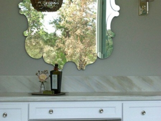 Elegant marble vanity and nickel sconces