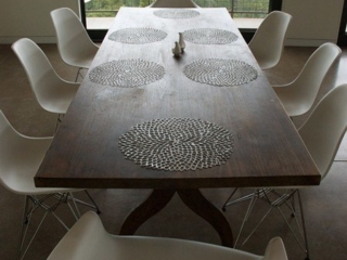 Eames sculptural chairs combined with a rustic teak table.