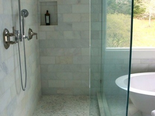 Calacutta marble throughout warms this rooms spa environment.