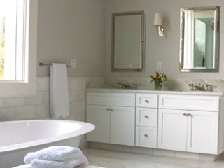 Gleaming nickel sconces and medicine cabinets