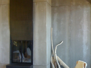 Steel fireplace and Contemporary Leather lounge chair.